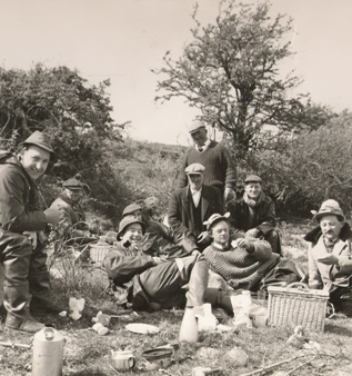 Jim Kelly (RIP) seated centre with a group of anglers from Wales and one of the earlier Kelly Kettles in the foreground on the banks of Lough Conn in the 1960's