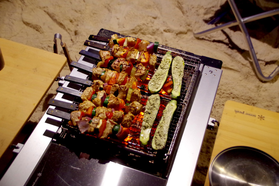 Jakes sister Nika cooks up some tasty kebabs on the beach.